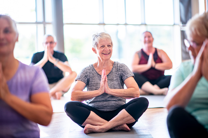 Edgemere residents taking a yoga class in the community fitness center