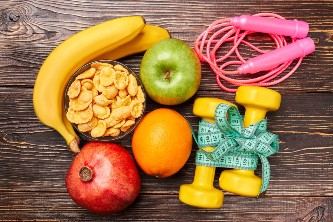 a colorful photo of fruits and workout equipment